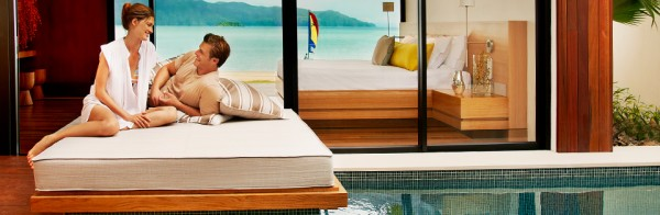 Couple Relaxing In A Hayman Beach Villa 600x196 Best 10 Luxury Honeymoon Resorts