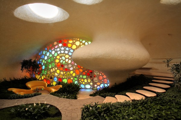 Eye cacthing organic architecture with whimsical interior for Colorful whimsical living room