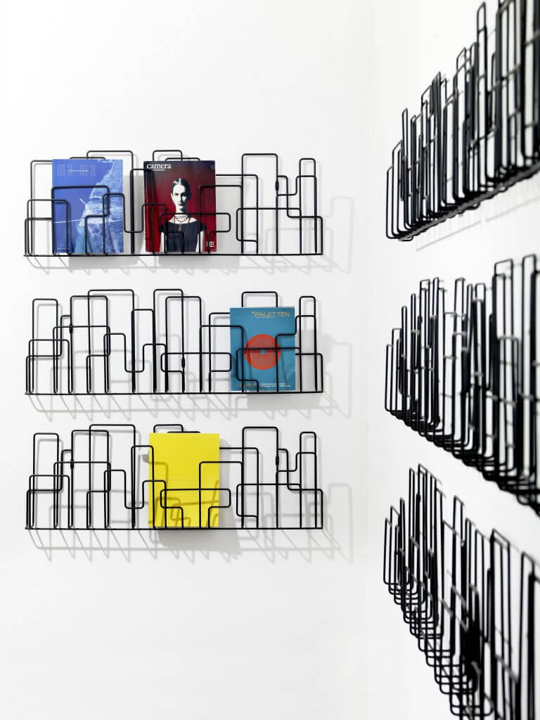 wall mounted magazine rack inspired by city structures