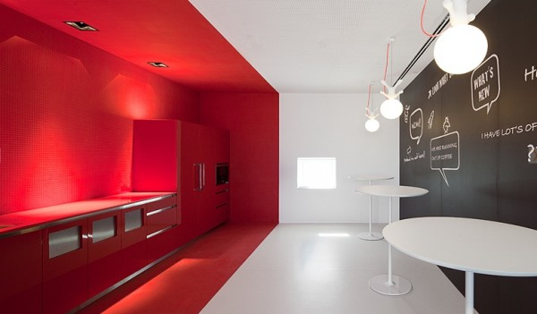 red-accent-wall-in-office-kitchen