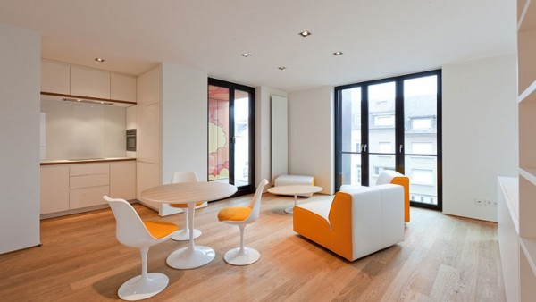 dining-room-with-white-and-orange-chairs
