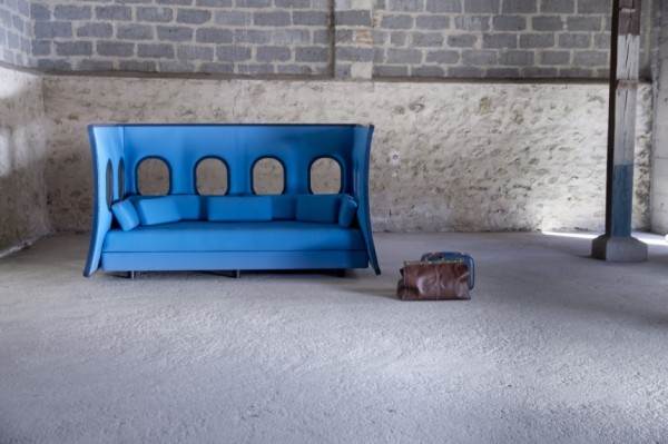 Industrial decor with blue sofa 600x399 Original Sofa Design Inspired by the Panel of an Airplane