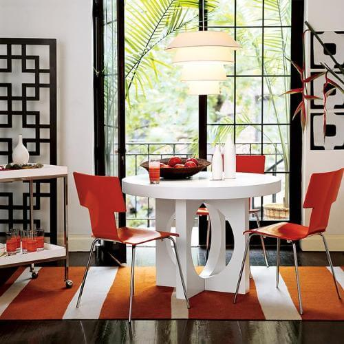 Red accent small dining area 6 Tips for a Small Dining Room