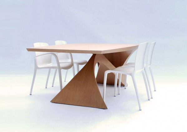 Sculptural table with white chairs 600x424 Form Follows Function Table by Daan Mulder