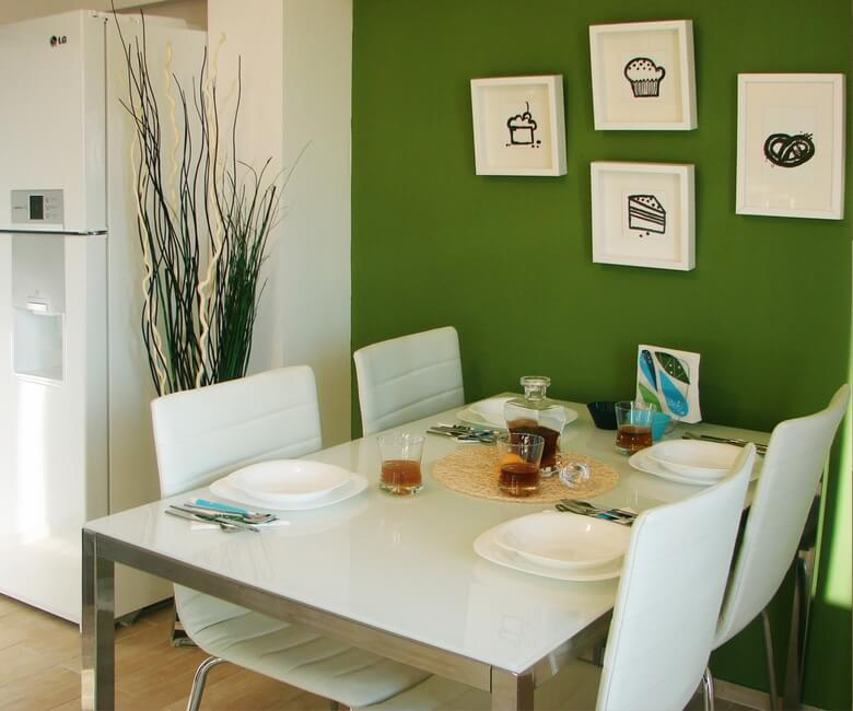 Green and white modern kitchen Fresh Small Apartment on the Edge of Modern Style