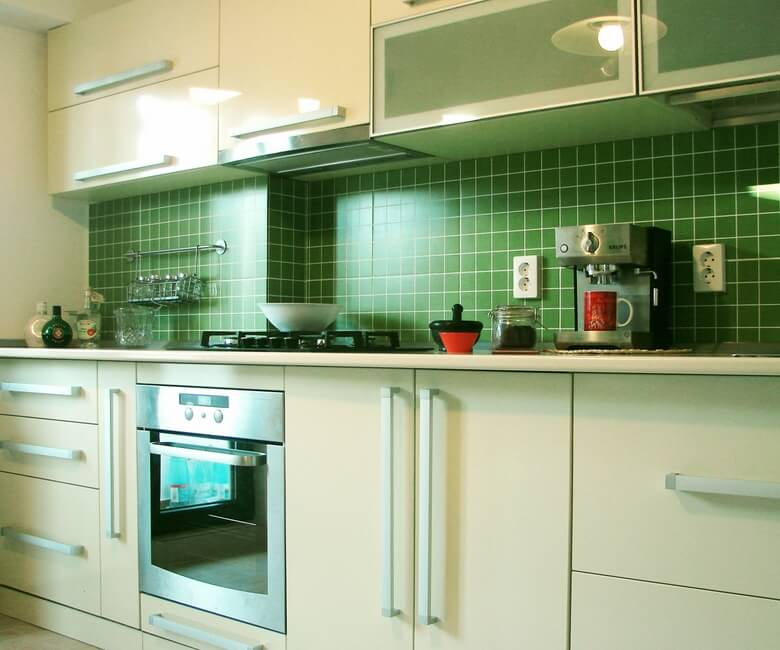 Modern kitchen furniture with green tiles Fresh Small Apartment on the Edge of Modern Style