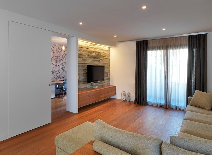 Modern living room with wood flooring Private House Showcasing a Volumetric Structure in Italy
