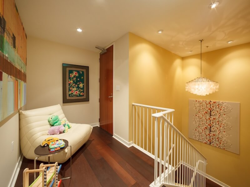 Yellow accent wall and white stairs Luxury Duplex Residence with Bay & City Views in San Francisco