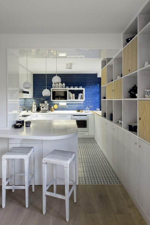 wood cabinet 600x899 White and Blue Kitchen Interior Design Tips