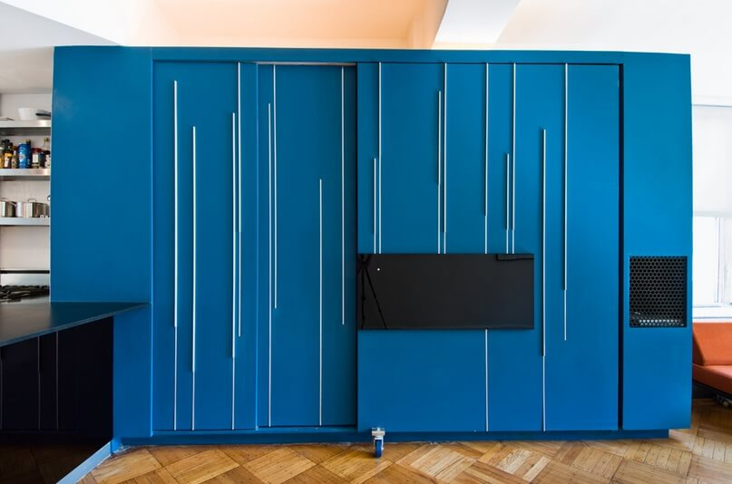 Blue custom cabinetry Small Apartment Design Exhibiting Creative Space Efficient Ideas