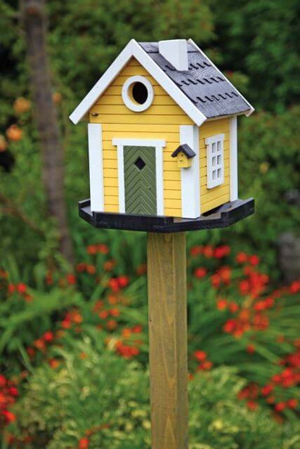 Cottage yellow birdhouse 10 Birdhouses to Decorate Your Outdoor Space this Spring
