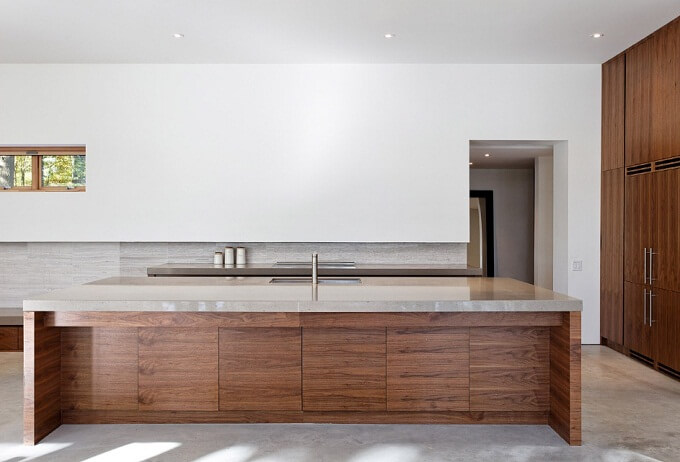 Elegant minimalist kitchen Sustainable Home Surrounded by a Privileged Natural Setting
