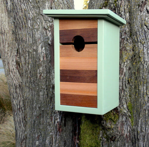 Minimal mint birdhouse 10 Birdhouses to Decorate Your Outdoor Space this Spring