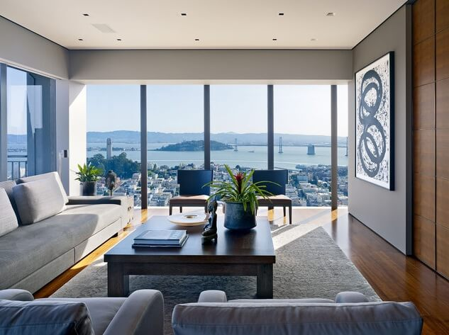 Modern living room with abstract art and city views How to Make Your Home More Attractive and Modern with Abstract Art