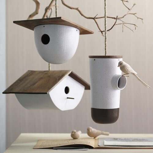 Modern white birdhouses 10 Birdhouses to Decorate Your Outdoor Space this Spring
