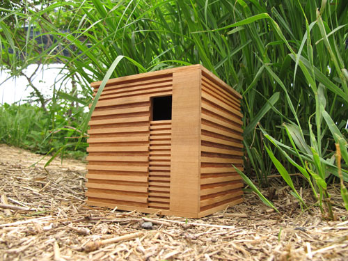 Modern wooden birdhouse 10 Birdhouses to Decorate Your Outdoor Space this Spring