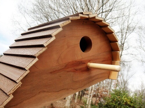 Unique wood birdhouse 10 Birdhouses to Decorate Your Outdoor Space this Spring