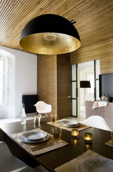 Dining table with modern lamp Contemporary Apartment Renovation in the Gothic Quarter, Barcelona