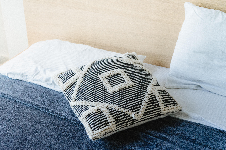 white and gray throw pillow